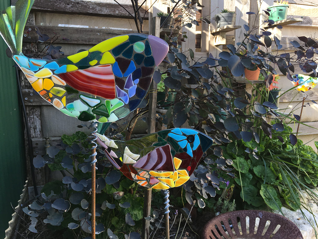 Slumped glass Garden Birds by Anne Morrison look right at home in the Wabi Sabi garden