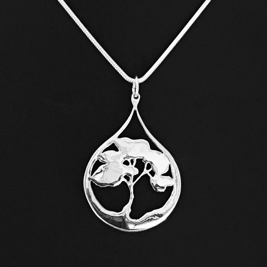 Closeup view of Fred Peters' sterling silver pendant 'Desert Tears', from his Trees series