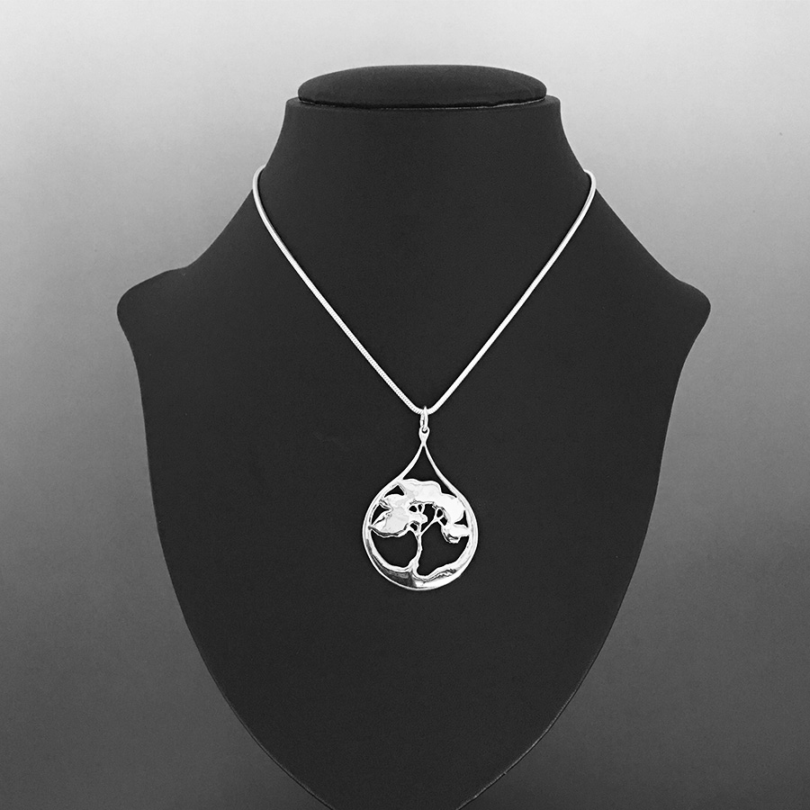 Model view, Desert Tears sterling silver pendant is from the Trees series
