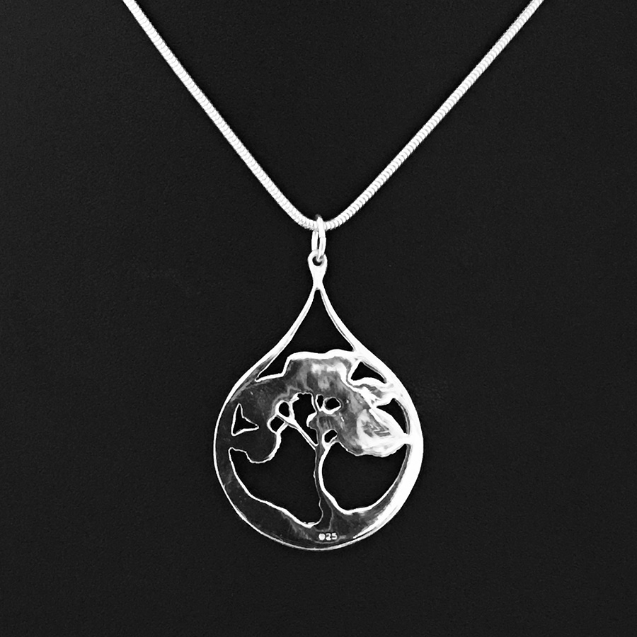 Reverse side of Fred Peters Desert Tears pendant in sterling silver.