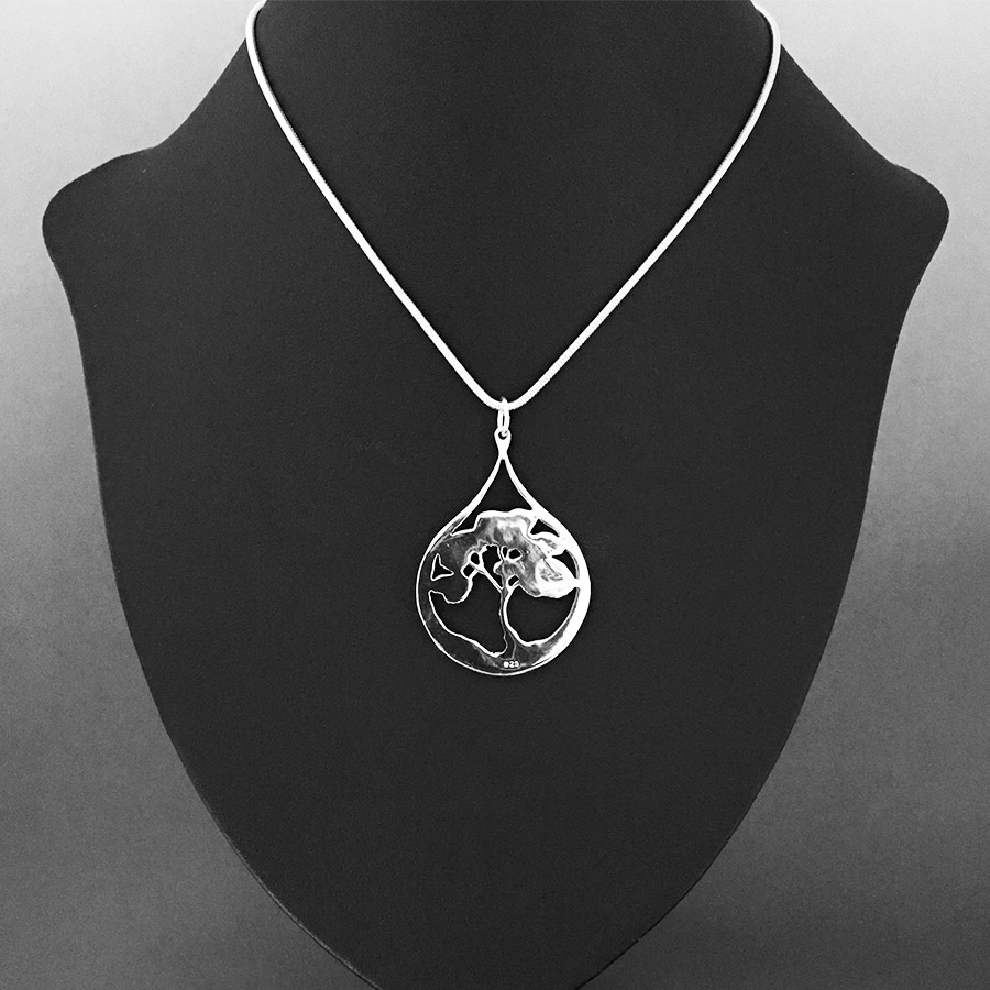 Reverse view on model shows Desert Tears necklace by Fred Peters with Hallmark visible