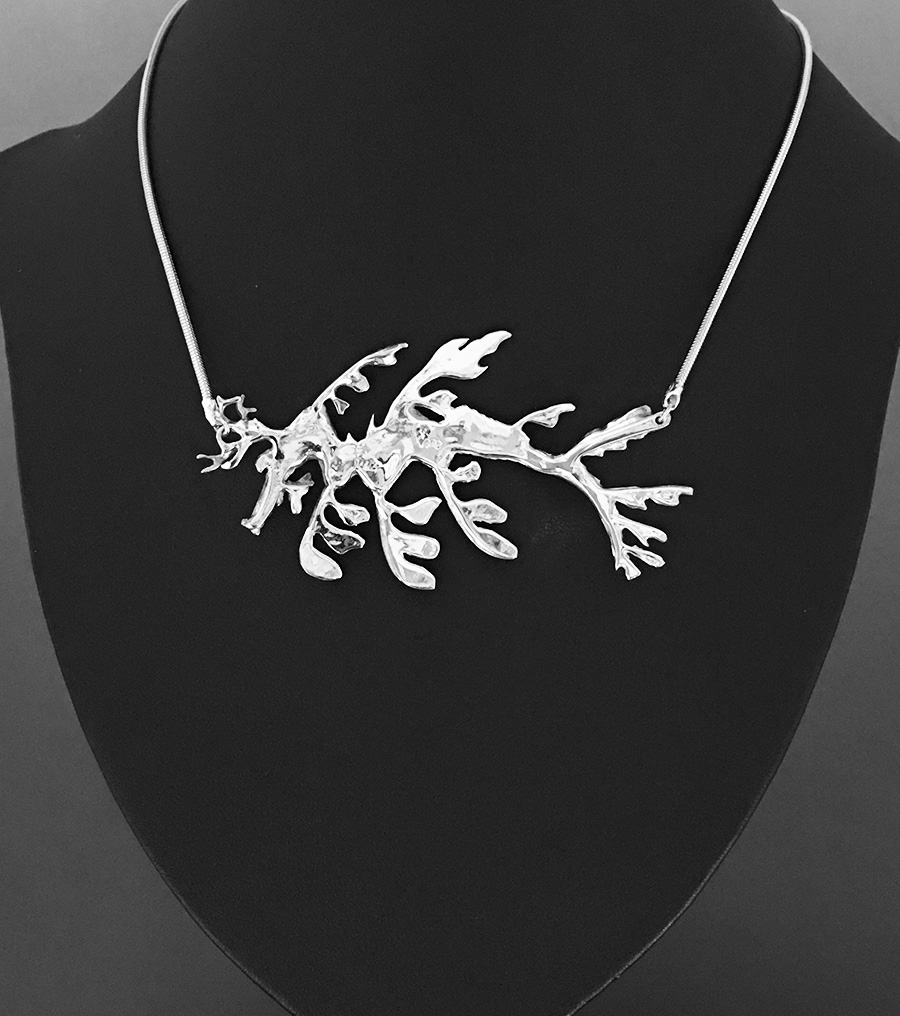 Reverse side of the Leafy Seadragon necklace shows artist's hallmark