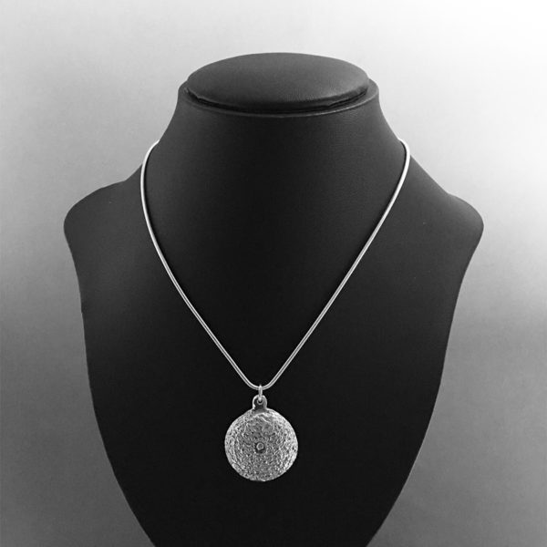 Cuttlefish cast Sea Urchin necklace on model