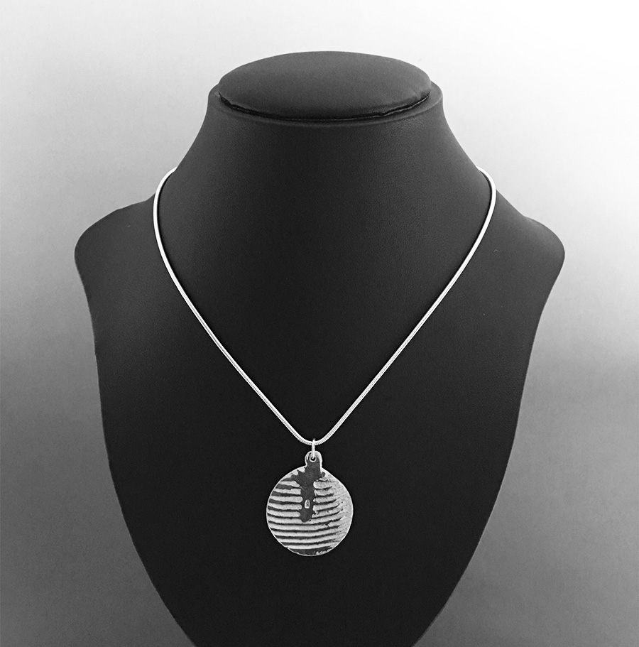 Reverse side of cuttlefish cast sterling silver sea urchin pendant necklace. Hallmark is visible in this image.
