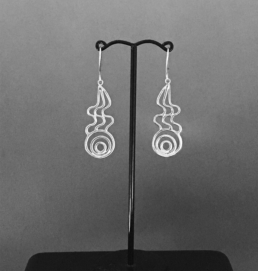 Hanging view of Waterfall earrings in sterling silver by Fred Peters